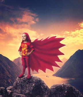 Super hero girl in mountains