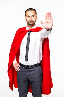 白い背景で隔離の一時停止の標識を作るスーパーヒーロー