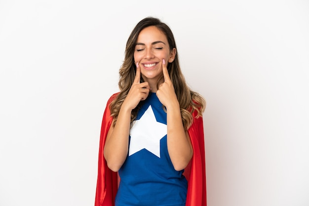 Super hero woman over isolated white background smiling with a happy and pleasant expression