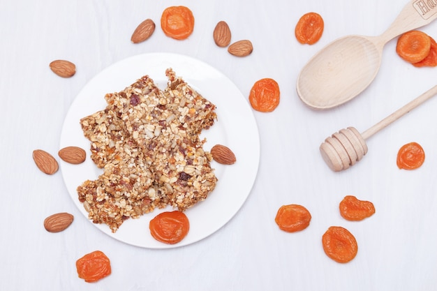 Superfood breakfast granola bars with oats, nuts, berries, fruits. top view, flat lay.