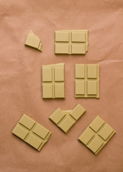 Superfood chocolate with matcha tea on a brown background. view from above