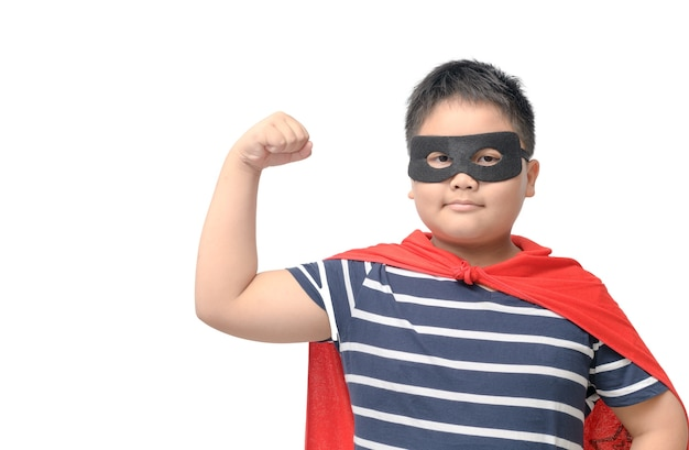 Superhero boy shows muscles isolated on white