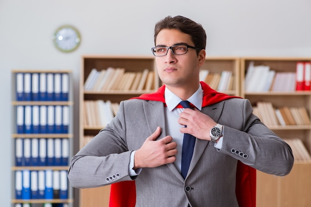 Superhero businessman working in the office