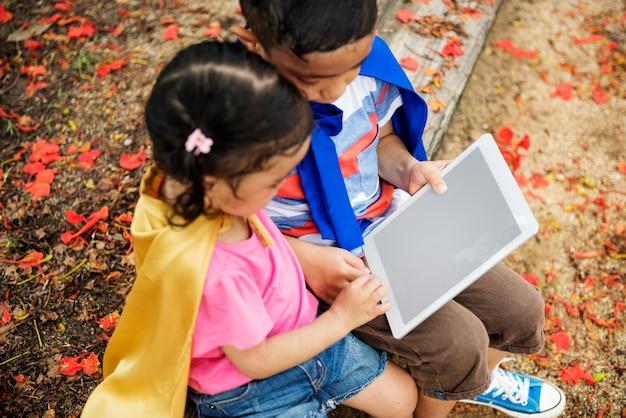 Superhero kid digital tablet copy space playful concept