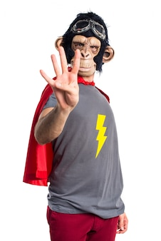 Superhero monkey man counting four
