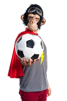Superhero monkey man holding a soccer ball