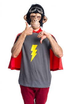 Superhero monkey man making good-bad sign