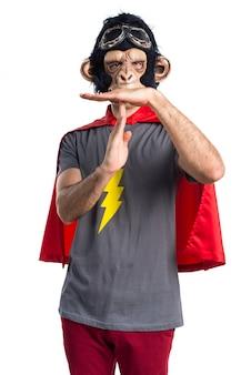 Superhero monkey man making time out gesture