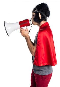 Superhero monkey man shouting by megaphone