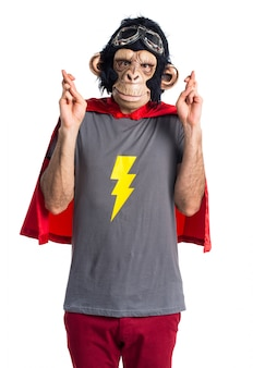 Superhero monkey man with his fingers crossing
