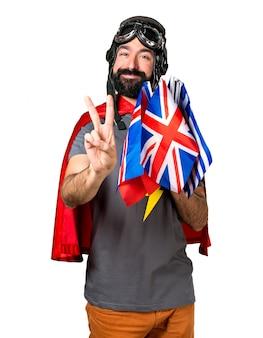 Superero con un sacco di bandiere che contano due