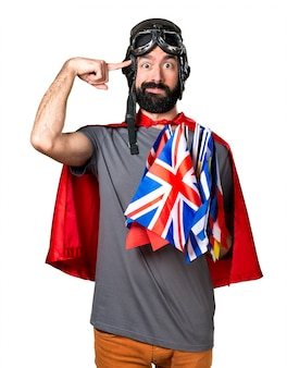 Superhero with a lot of flags making crazy gesture