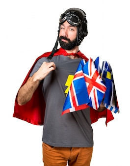 Superhero with a lot of flags proud of himself