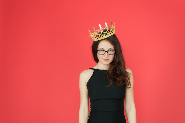 Superiority and excellence. woman queen red background. sexy girl wear crown. big boss concept. ambitious and successful. glory and triumph. success in business. luxury fashion accessory. my kingdom.