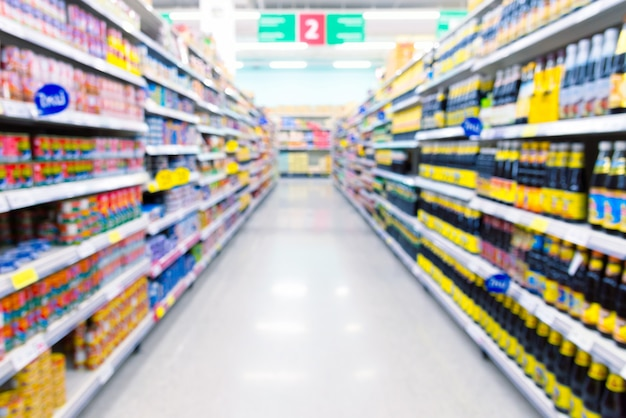 Supermarket aisle with products on shelves. defocused background.