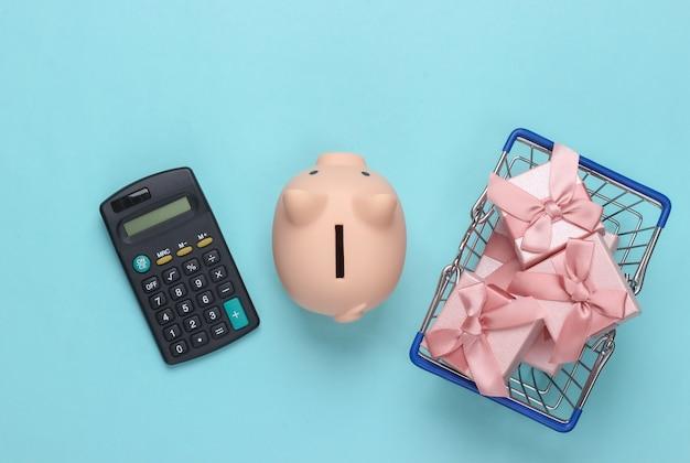 선물 상자, 돼지 저금통, 파랑에 계산기와 슈퍼마켓 바구니.