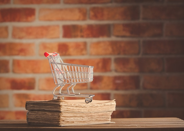 Supermarket cart and old books