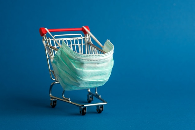 Supermarket cart for shopping with mask