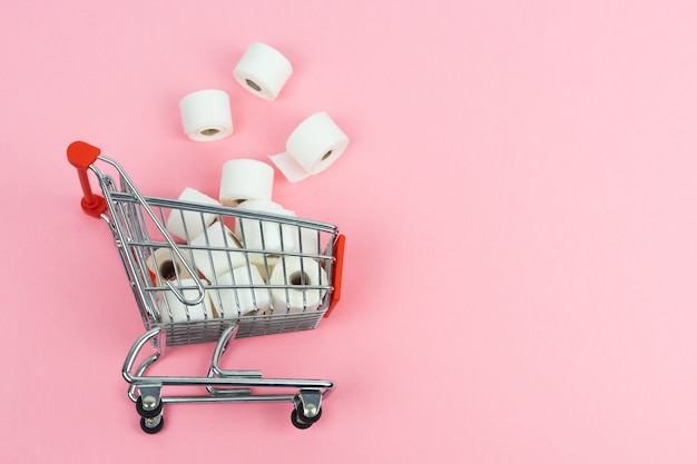 Supermarket cart with toilet paper thrown on the floor. covid-19 concept. copy space.