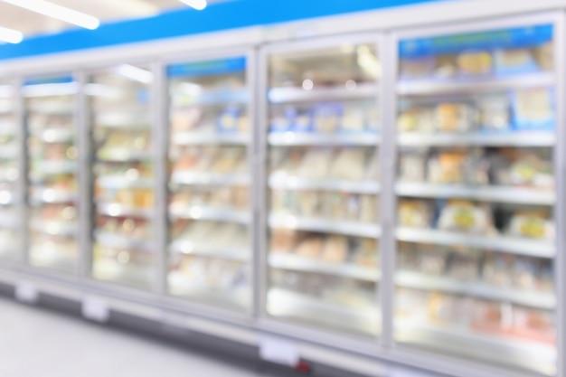 Supermarket refrigerators freezer blur background