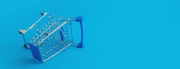 青い背景の上のスーパーマーケットのトロリー