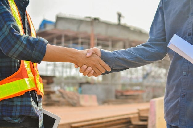 Supervisor shake hand foreman success agreement project building construction