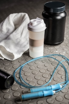 Supplements and rope on the floor at the crossfit gym