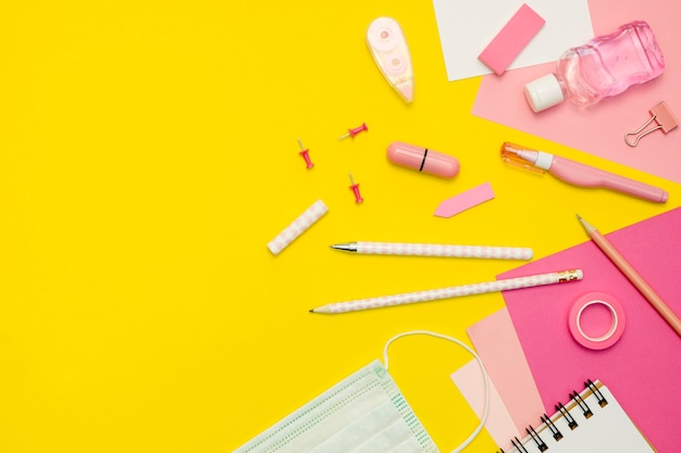 Supplies arrangement on yellow background