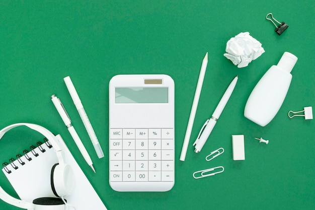Supplies for school on green background