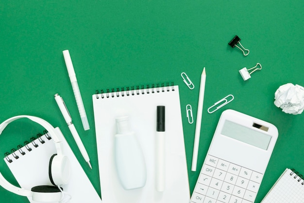 Supplies for school with green background
