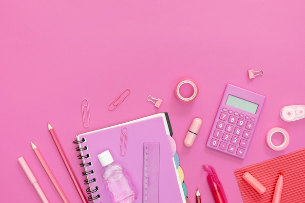 Supplies for school with pink background