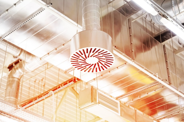 Supply and exhaust ventilation system on ceiling of a commercial room or warehouse