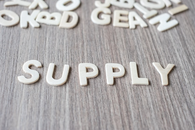 Supply word of wooden alphabet letters. business and idea concept
