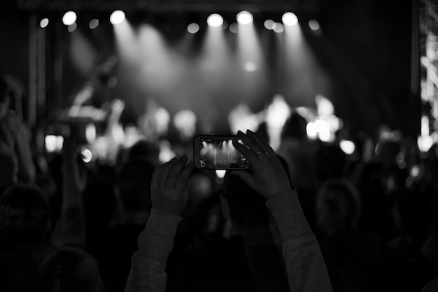 Supporters recording at concert