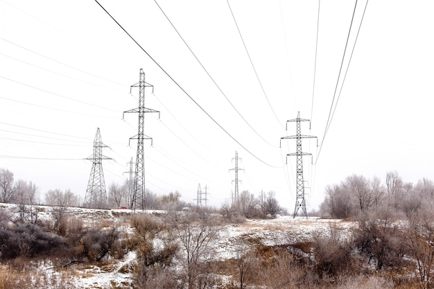 Supports high-voltage power lines in winter