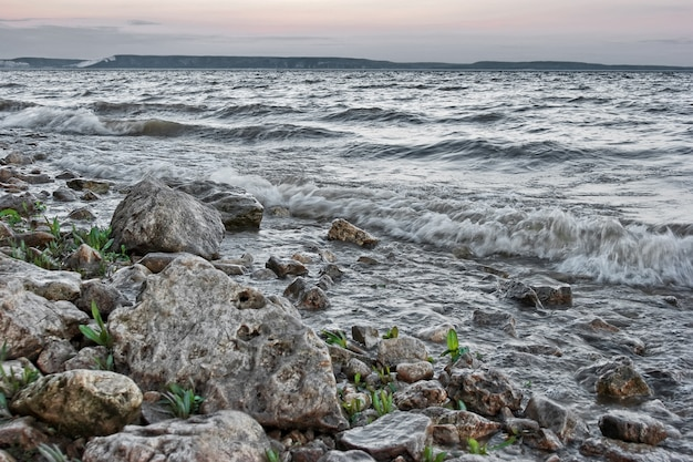 Surf on rocky shore in evening. hdr