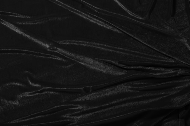Surface of black corduroy with folds