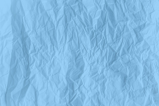 Surface blue color crumpled paper close up texture