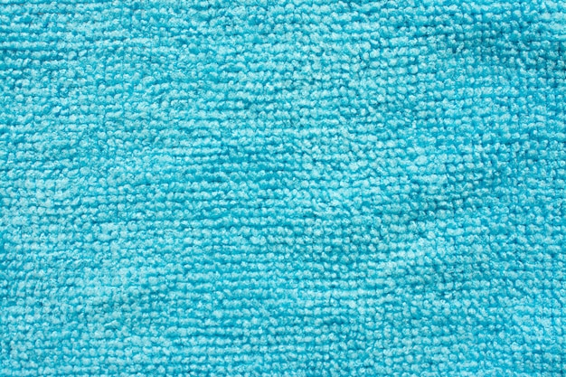 Surface of blue microfiber cloth, macro textile pattern background