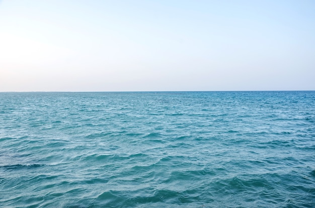 Surface of blue sea water and sky horizon