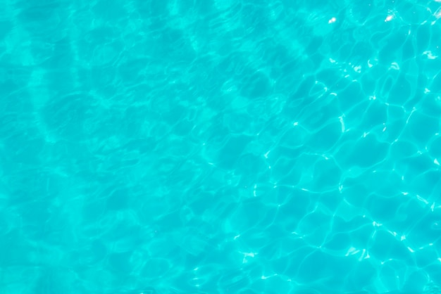 Surface of blue swimming pool