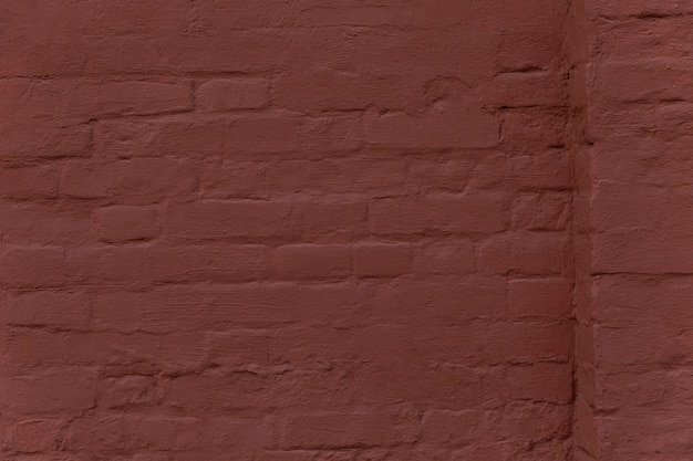 The surface of a brown brick wall with a ledge. background. space for text.