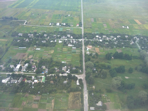 The surface of the earth was taken from the height of the aircraft. below - roads and parcels of land and fields