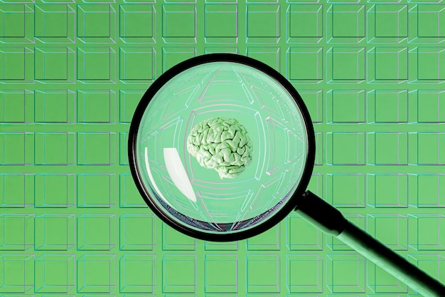 Surface of empty cubes with a magnifying glass in the center showing a brain