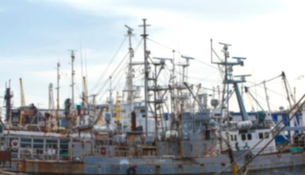Surface of fishing vessels near pier in seaport