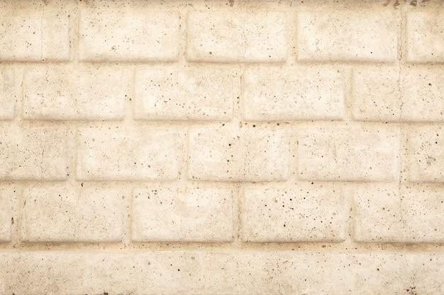 Поверхность из искусственных камней бежевого цвета. каменная текстура с копией пространства.