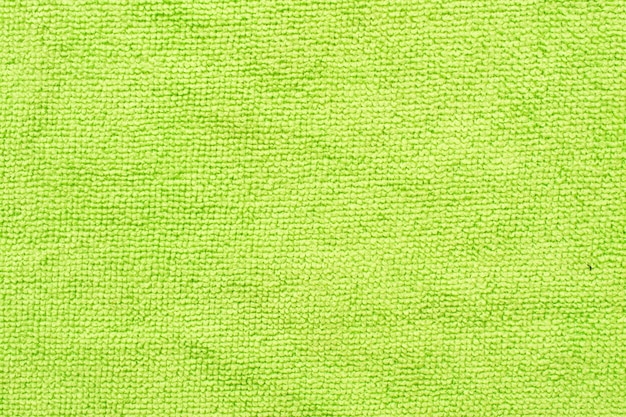 Surface of green microfiber cloth, macro textile pattern background