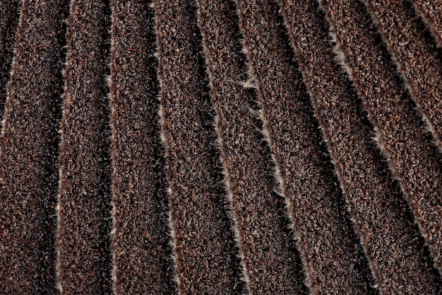 The surface of the grinding material with fine elements of abrasive