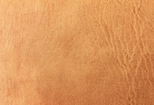 The surface is light brown eco-leather.background, leather texture.