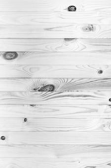 Поверхность натуральной деревянной доски черно-белый фон. плоская планировка, крупный план старинной монохромной фотографии, текстурированный эффект.